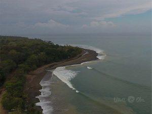 aerial view of waves at Rio Claro de Pavones